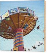 Swings Wood Print by Leslie Leda