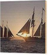 Tall Ships At Sunset Wood Print by Cliff Wassmann