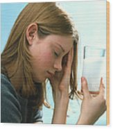 Teenager With Headache Holds Dissolving Painkiller Wood Print