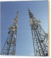 Telecommunications Masts Wood Print by Carlos Dominguez