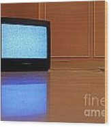 Television Displaying Static Reflected In Floor Wood Print