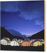 Tents Illuminated In A Valley At Night Wood Print