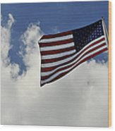 The American Flag Blowing In The Breeze Wood Print