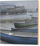 The Green Canoe Wood Print by Debra and Dave Vanderlaan
