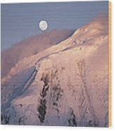 The Moon Rises Over Snow-blown Peaks Wood Print