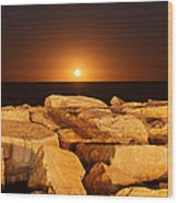 The Moon Rising Behind Rocks Lit Wood Print