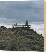 The Structure Of An Abandoned Temple On The Top Of A Green Covered Hill With Blue And White Clouds I Wood Print