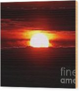 The Sun Falling Into Clouds Wood Print