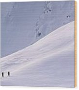 Three Hikers Walking Up A Snow Covered Wood Print