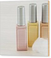 Three Makeup Bottles Wood Print by Blink Images