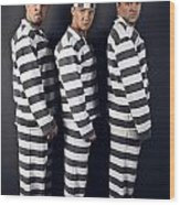 Three Prisoners. Group Of Men In Suits Of Convicts. Wood Print
