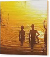 Three Young Kids Fishing On The Lake At Sunset Wood Print