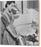 Tired Woman At Kitchen Sink, (b&w), Elevated View Wood Print