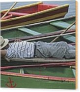 Tour Boat Guide Naps Amidst Rowboats Wood Print by Raymond Gehman