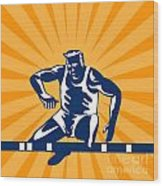 Track And Field Athlete Jumping Hurdles Wood Print by Aloysius Patrimonio