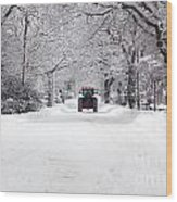 Tractor Driving Down A Snow Covered Road Wood Print