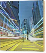 Traffic Trails In City Wood Print by Leung Cho Pan