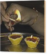 Trying To Light An Oil Lamp That Has Gone Out Wood Print