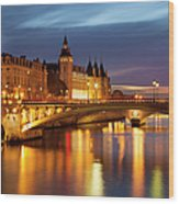 Twilight Over River Seine And Conciergerie Wood Print
