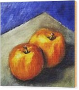 Two Apples With Blue Wood Print