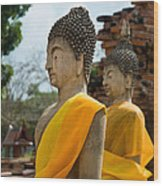 Two Buddha Statues Wrapped In An Orange Scarf  Wood Print