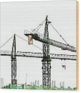 Two Cranes On A Construction Site Wood Print by Yali Shi