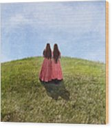 Two Girls In Vintage Dresses Walking Up Grassy Hill Wood Print
