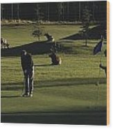 Two People Play Golf While Elk Graze Wood Print