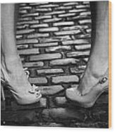 Two Young Women Wearing High Heeled Shoes And Fake Tan On Cobblestones On A Night Out Wood Print by Joe Fox