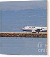 United Airlines Jet Airplane At San Francisco International Airport Sfo . 7d11998 Wood Print by Wingsdomain Art and Photography