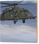 U.s. Air Force Hh-60 Pave Hawks Conduct Wood Print