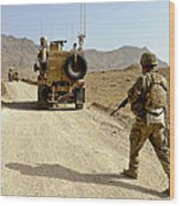 U.s. Army Soldier Moves To His Mrap Wood Print