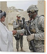 U.s. Army Soldier Shakes Hands With An Wood Print