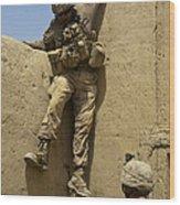 U.s. Marine Climbs Down From An Wood Print