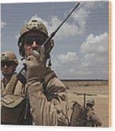 U.s. Marine Uses A Radio In Djibouti Wood Print by Stocktrek Images