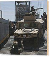 U.s. Marines Load An M1114 Humvee Onto Wood Print