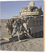 U.s. Soldiers Exit From An M2 Bradley Wood Print