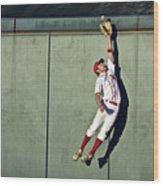 Usa, California, San Bernardino, Baseball Player Making Leaping Catch At Wall Wood Print