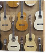 Various Guitars Hanging From Wall Wood Print