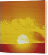 View Of The Sun Setting Behind A Cloud Wood Print