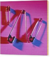 View Of Three Safety Pins Wood Print