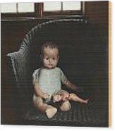 Vintage Dolls On Chair In Dark Room Wood Print