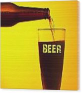 Waiter Pouring Dark Beer Wood Print by Anna Om