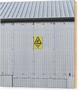 Warning Sign On An Industrial Building Wood Print