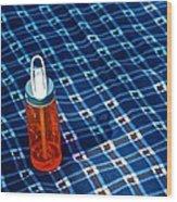 Water Bottle On A Blanket Wood Print