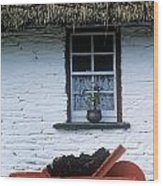 Wheelbarrow In Front Of A Window Of A Wood Print