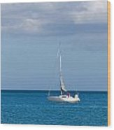 White Yacht Sails In The Sea Along The Coast Line Wood Print