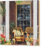Wicker Chair With Striped Pillow Wood Print