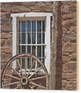 Window In Stone Building With Wagon Wheel Wood Print by Thom Gourley/Flatbread Images, LLC