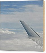 Wings Of Flying Airplane Over Clouds Wood Print